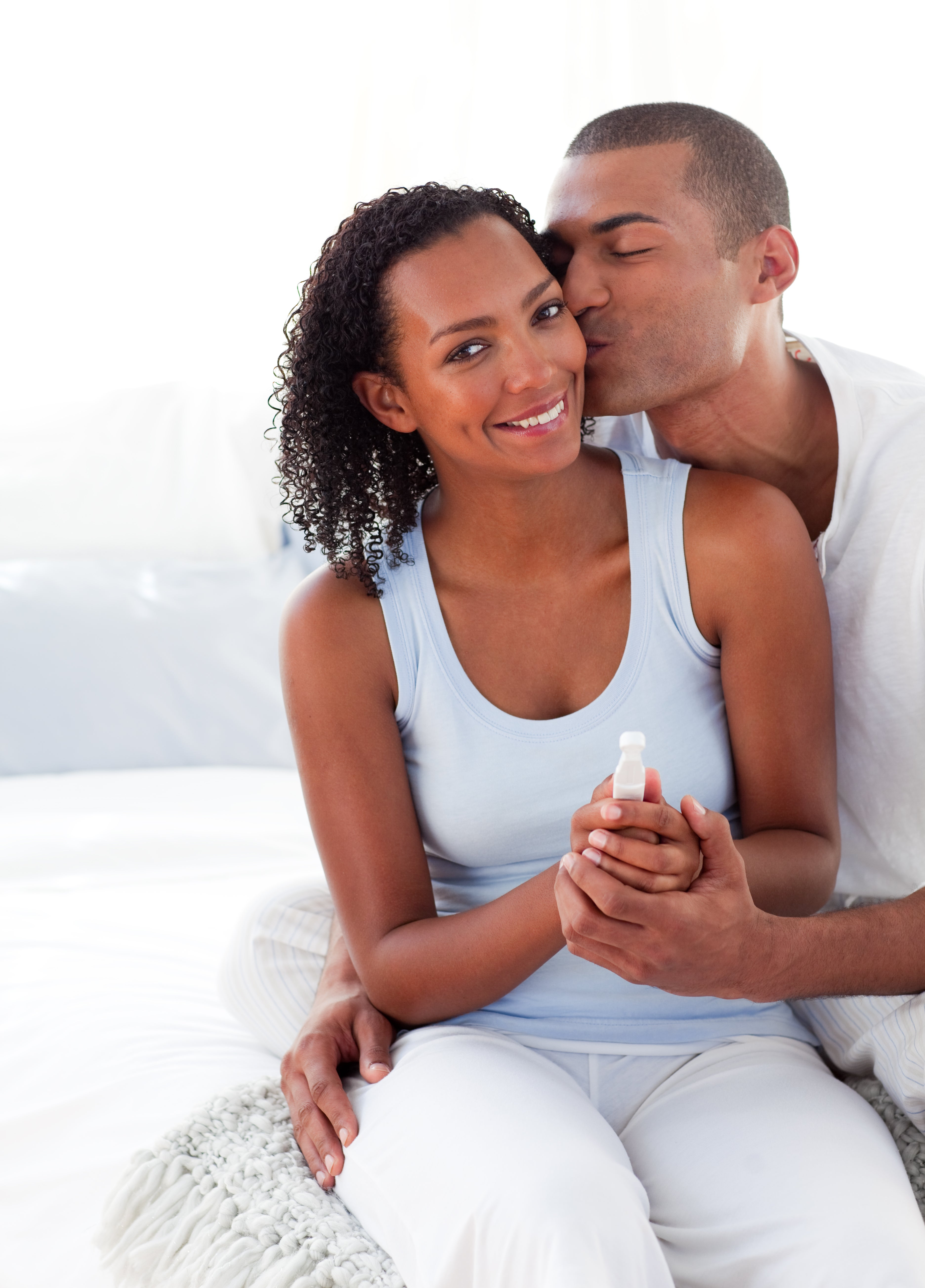 A couple trying to get pregnant takes a pregnancy test